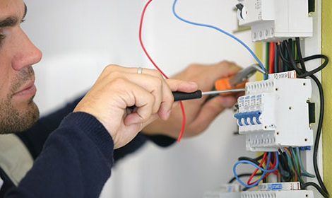 electrician installing a distribution board